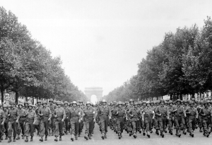By definition, moving a large grouip 'by their hosts' requires organization and leaders. Exampled here in picture are Americans troops marching down the Champs Elysees upon the liberation of Paris.